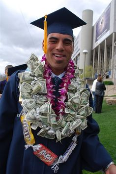 He was actually wearing three leis!  A traditional flower lei but then he also had a candy lei and a money lei.  The candy lei was made out of plastic wrap and candy bars and tied in between each candy bar with ribbon