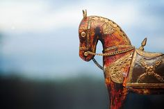 Rùnach smiled, then tucked the map into a pocket of his cloak, then pulled off his pack and took out a finely carved wooden statue of a horse. ~ Lynn Kurland ~ Dreamer's Daughter