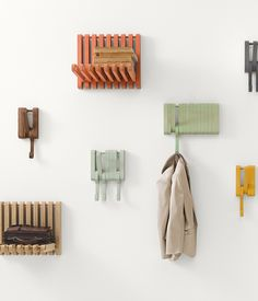 Juhana Myllykoski's Hidden collection for Sculptures Jeux includes a series of of shelves and hooks that provide a playful and unobtrusive solution to storing coats and bags.