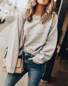 Cute beaded sweater with blue jeans.