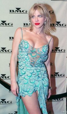 Courtney Love.  Until this moment, I never knew that a dress could be both beautiful and trashy at the same time.