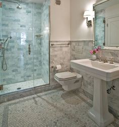 I love the marble subway tile on the walls and the penny rounds on the floor.