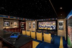 Notre Dame-Themed Home Theater featuring Crestron Integrated By Design™ home technology solutions, including AV, lighting control, and DigitalMedia™. Home Theater Setup, Best Home Theater, Outdoor Theater, Home Theater Rooms, Home Theater Design, Home Theater Seating, Basement Movie Room, Man Cave Home Bar, Home Technology