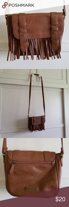 """Madden girl brown fringe purse Madden girl brown fringe purse. 3 inside pockets, one outside pocket. Only used once or twice. In excellent condition. Strap measures 51.5"""" Madden Girl Bags Crossbody Bags"""