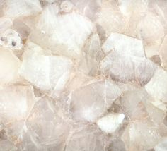Classic quartz boasts a unique quality among precious stones; it performs helically, meaning that its internal structure grows in a striking spiral form. Because this stone is translucent, the visual effect and color change dramatically when back-lit (as in the previous photo). Suitable for all indoor applications.