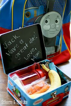 Chalkboard paint the inside of the lunchbox. Kids will love a little bit of love from home during their day,