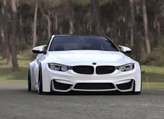 BMW F82 M4 white widebody slammed