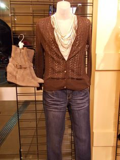 Try this casual and comfy outfit this fall. The brown cardigan, and  cream beaded top look awesome with skinny jeans and grey wedge booties. At Clothes Mentor-Alliance Center.