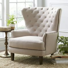 Features:  -Made of linen blend.  -Spot clean only.  -Imported.  Chair Design: -Arm chair.  Frame Finish: -Natural.  Upholstered: -Yes.  Frame Material: -Wood.  Upholstery Material: -Linen.  Arm Mater
