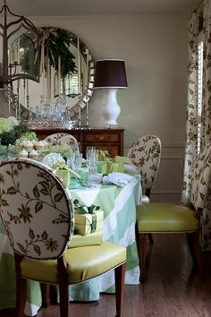 Soleil Mirror #design #inspiration #interiors  Love all the details except the table cloth.  I would have chosen something which didnt try to compete with the print on the windows and chairs.  Otherwise love it.