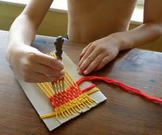 easy weaving.  cut slices in card board, yarn and a toothpick