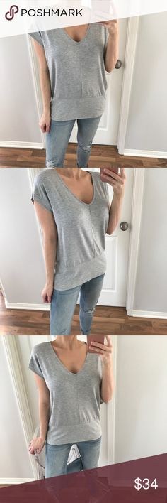 """Grey Ribbed Basic Top Such a cute basic! Lays perfectly on your body with a relaxed fit. Features a v-neckline, short sleeves that have a ribbed hemline as well as the bottom of the top with a tuxedo style body. The fabric is extremely soft & smooth. You'll want this in every color! Available in Black & Grey    Modeling: M Measures: 26"""" L in front • 30"""" L in back • 19"""" C Size Difference: 1"""" all over Fabric: Rayon & Spandex  • Please use the """"Buy Now"""" or """"Add To Bundle"""" feature to purchase…"""