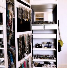 Jewelry Organized in slide-out drawers/racks & hanging hooks (lots of wasted opportunity w/ so much space between the drawers -- could add a couple of shelves for shoes or purses)