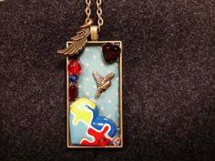 For National Autism Day - Give Them Wings Autism Awareness Puzzle Piece Shadowbox Pendant by RemembrancesofYours on Etsy