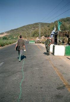 Francis Alys recreating a political border between Israel and Jordan.