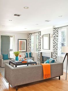 Modern Gray living room with turquoise and orange accents... black and white drapes. I love the clean crisp look but still inviting