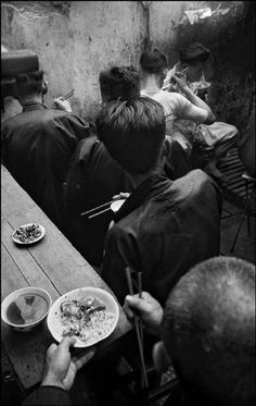 HONG KONG. 1952. Lunch time Werner Bischof