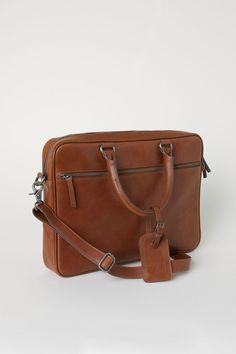 Shoulder bag in thick leather with two handles, one with detachable address tag. Detachable, adjustable shoulder strap and zip at top. One outer compartment with zip and one inner compartment with zip. Lined. 2 x 10 x 15 in. Small Shoulder Bag, Leather Shoulder Bag, Leather Bag, Shoulder Strap, Thick Leather, Cloth Bags, Saddle Bags, Beige, Brown