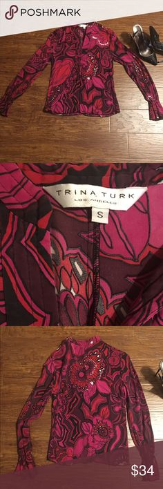 "Trina Turk silk blouse with poet sleeves Beautiful silk blend floral paisley print blouse by Trina Turk. Size small. 93% silk 7% spandex made in the USA dryclean only. Excellent preowned condition. No flaws or stains/odors 🚫MEASUREMENTS LAYING FLAT:   Armpit to armpit:16"" Waist:  14"" Length from shoulder to bottom:  22.5"" Sleeve:  32.75"" Trina Turk Tops Blouses"