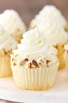 These Almond Amaretto Cupcakes have a moist almond cupcake, almond frosting and a fluffy white chocolate amaretto center!