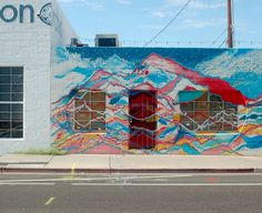 40 Favorite Murals in Phoenix - Mural by Sierra Joy 16. Untitled work by Sierra Joy  This mural is very painterly, but we appreciate the abstraction. From a distance the mountain forms reveal themselves, and the natural subject becomes clearer on the south-facing well of The Dressing Room on Third Street and Roosevelt.