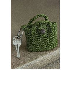 Purse Key Chain by Mary Jane Hall from Positively Crochet! (a book of 50 patterns -garments & accessories) This is one of the most popular projects in the book! They make great gifts.