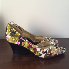 Rampage Floral Fabric and Black Patent Wedges 7 Rampage Floral Fabric and Black Patent Wedges in size 7 with pretty floral fabric, gold tone inside, and black patent wedge. Dress up or down, they are sure to be eye catching! Worn a few times, they have some wear on the bottom sole. Bottom sole has some fabric style treading which is non-slip. I had a cushion attached to the inside, so shows what was left of the adhesive. They have been cleaned and sanitized. Rampage Shoes Wedges