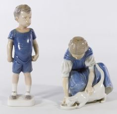 Lot 748: Bing & Grondahl Figurines; Two glazed porcelain items made in Denmark including a standing boy #1617 with a ball in his right hand and a #1745 girl feeding a cat
