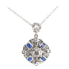 """Diamond and Sapphire Cluster Pendant. Description : Original pendant restyled for contemporary wear features a rose-cut diamond on top, and a central old mine-cut diamond flanked by baguette sapphires and rose-cut diamonds. Included 14k white gold chain adjusts from 16"""" to 18"""". Creator unknown / Mindi Mond. Revival period. Circa 1790-1829 14k gold, silver, white gold, diamond, sapphire. 