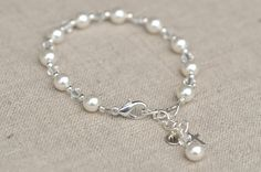 This lovely Swarovski pearl and crystal First Communion bracelet is sure to be the perfect gift.The bracelet is finished with a sterling silver cross charm. Bracelet measures 5 ½ inches plus a 1 inch extension chain. Girls Jewelry, Jewelry Gifts, Handmade Jewelry, Craft Jewelry, Handmade Bracelets, Communion Gifts Girl, Silver Bracelets, Beaded Bracelets, Silver Ring