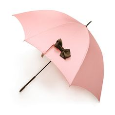 Blush pink umbrella with a pretty brown bow.