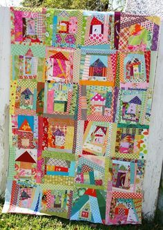 Wonky House Log Cabin Quilt, made by her quilting bee, at Better Off Thread.  Wow!  I love this quilt - what a great way to use up your stash!!!