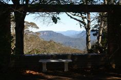 ideas for our garden. the view here is literally framed by the structure and seating to enjoy it at leisure.  View from terrace garden, Everglades House, Leura, Blue Mountains Australia