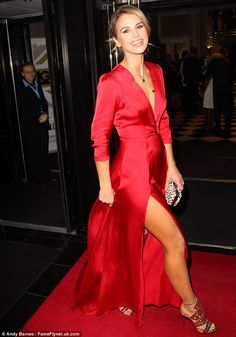 Flashing the flesh: The 30-year-old cut a classically elegant figure in the silk dress, which showcased her perfect pins with a daring thigh-high split