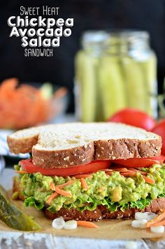 Smashed chickpeas (garbanzo beans) and avocado together make the most delicious sandwich spread! Get this Sweet Heat Chickpea Avocado Salad Sandwich recipe at TidyMom.net