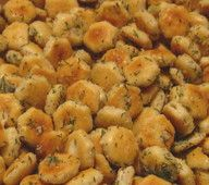Most addicting snack.. I have been looking for this. . .     1 (1 oz) package ranch dressing mix  1/4 cup canola or vegetable oil  1/2 t garlic powder (or to your taste)  salt to taste  1 box or bag oyster crackers  Preheat oven to 250°.  In a large mixing bowl, combine first 5 ingredients and mix well. Stir in oyster crackers mix to coat. Pour crackers onto a large cookie sheet.  Bake 15 minutes, stirring every 5 minutes or so.  Cool and add to a covered container.