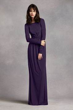 Stunning and elegant, Stand out in this lovely long sleeve jersey dress!  Long sleeve bodice with boatneck neckline features plunging V-back.  Long soft jersey skirt has eye catching knot twist detail at waist.  Fully lined. Back zipper. Imported polyester. Dry clean only.  Sizes and colors are available in limited stores and with limited availability.