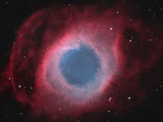 The Helix Nebula (aka NGC 7293), is a planetary nebula, produced near the end of the life of a sun-like star. The Helix is a mere seven hundred light years from Earth, in the constellation Aquarius.