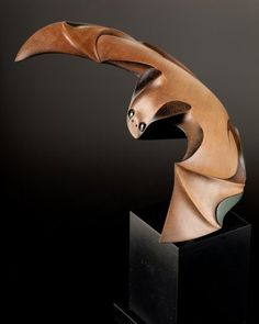 """Medium: kauri, hematite, painted MDF base. Size: 10 x 8 x 8 inches (incl. base). Endemic to New Zealand, the only land mammal in existence when the Māori arrived over one thousand years ago was the Pekapeka or Lesser Short Tailed Bat. With a wingspan of 11"""" and a body length of 3"""" the Pekapeka is a relatively small creature."""