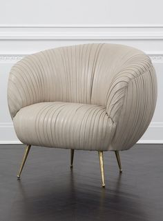 KELLY WEARSTLER | LEATHER SOUFFLE CHAIR. Exquisitely detailed lambskin leather chair on tapered legs of solid cast brass.