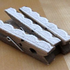 lace on clothespins to hold namecards, food labels, or table numbers.