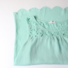 Mint Scalloped Tank Open Back Cute delicate tank with cutout design and scalloped detail in the back. Great condition. Beautiful top, photos don't do it justice! Additional pics and measurements available upon request! Mine Tops Tank Tops