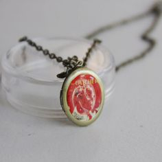The Catcher in the Rye locket w/ chain. $15.00, via Etsy.