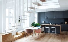 Modern Kitchen and dining room. Love the charcoal and timber with plenty of natural light. Inside World Festival of Interiors 2014 finalists announced