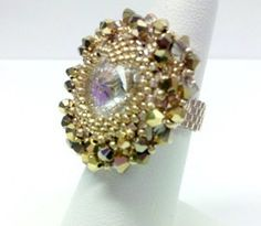 This is definitely a different kind of design that I have come up with! This ring features a rivoli bezeled into a heart shape; surrounded by Swarovski crystals for a brilliant sparkle! I chose Gold for my model since I love to wear Gold tones and colors… However, the color combinations for this piece are endless.