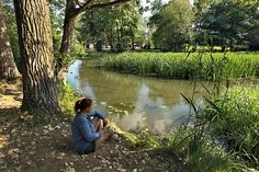 Relaxing by the Touristvandi River in Szatmar County in far eastern Hungary