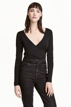 Wrapover top: Long-sleeved top in soft, glossy jersey with a deep V-neck and sewn-in wrapover front.