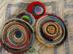 "Coasters made from wool roving ""worms"". Clever!"