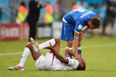Junior Diaz of Costa Rica lies on the pitch as Claudio Marchisio of Italy stands over during the 2014 FIFA World Cup Brazil Group D match be...