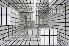 Esther Stocker – 2004, masking tape on wall, wood boxes, 13,3 x 5,6 x 3,4 m, AR/GE Kunst Galerie Museum Bozen, Photo: Martin Pardatscher.